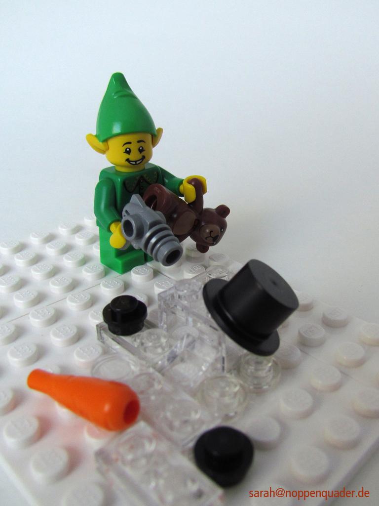 Wichtel föhnt Schneemann